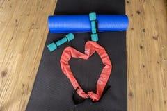 家庭锻炼辅助部件心脏 库存图片