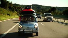 家用汽车用在路的材料填装了往暑假 影视素材