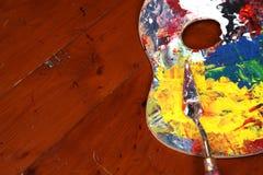 画家的调色板和刀子 免版税库存照片
