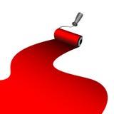 画家路辗洗染红色油漆 免版税库存照片