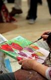 画家绘她的画 库存照片