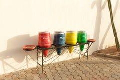 容器为收集的不同的颜色回收材料 免版税库存照片