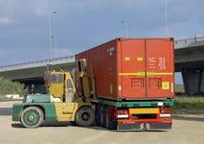容器增强的堆货机 库存照片