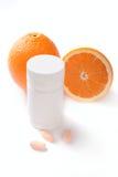 容器查出桔子药片维生素 库存照片