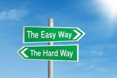 容易与困难方式路标 免版税库存图片