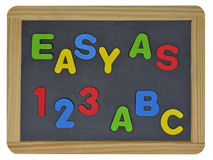 容易作为123在色的信件的ABC在板岩 免版税库存图片