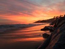 宽广的海滩日落 免版税图库摄影