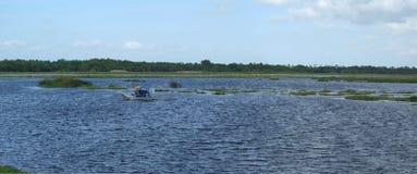 宽沼泽地有汽船的 图库摄影
