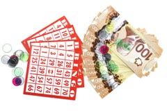 宾果游戏卡片、现金和标志 图库摄影