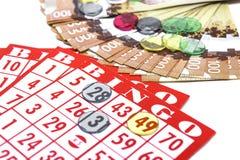 宾果游戏卡片、现金和标志 免版税库存图片