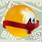 宾果游戏球和丝带在数字背景 免版税库存图片