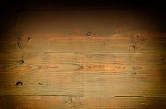 富有的黑暗的木背景 免版税库存照片