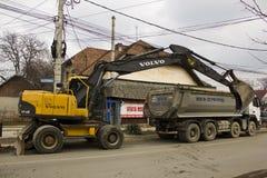 富豪集团挖掘机和卡车 免版税图库摄影