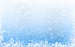 寒假与雪花的背景蓝色 库存图片