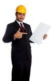 对一个垂直的空白的标志的亚洲工程师人点 库存图片