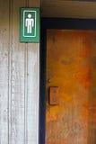 对一个男性洗手间的入口 免版税库存图片
