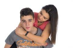 对一个年轻少年的后面的青少年的女孩攀登II 免版税库存图片