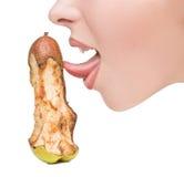 对位的女孩感人的舌头象梨的假阳具 免版税库存照片