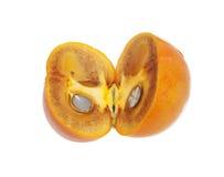 对分成熟的柿子 免版税库存照片