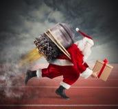 对圣诞节礼物交付的种族  免版税库存图片