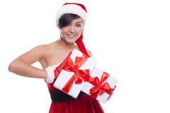 对圣诞节礼物微笑负的圣诞节亚裔妇女愉快 库存照片
