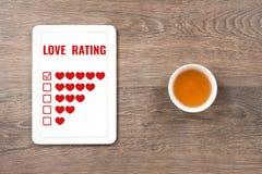 对在数字式片剂的爱五心脏估计 免版税图库摄影