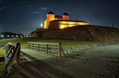 对城堡的桥梁在晚上 库存图片