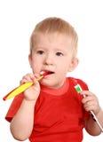 对培训的儿童干净的牙 免版税库存图片