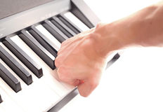对培训的愤怒吹动快速比赛钢琴 库存图片
