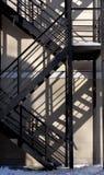 对墙壁的防火梯 免版税图库摄影