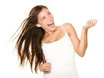 对妇女的跳舞的听的音乐 免版税库存照片