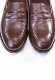 对时髦的布朗便士游手好闲者鞋子 免版税库存图片