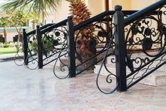 对村庄阶段的入口与在手段的扶手栏杆 免版税库存图片