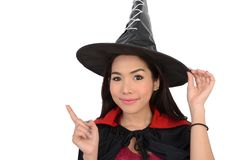 对某事的俏丽的巫婆点在右手 免版税图库摄影
