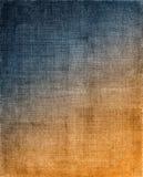 对橙色布料背景的蓝色 免版税库存照片