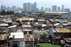 对比在富有和穷,马尼拉,菲律宾之间 免版税库存照片