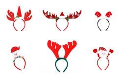对玩具驯鹿垫铁 在wh隔绝的圣诞节头饰带 免版税库存照片