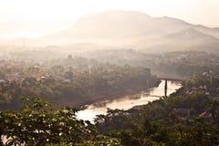 对琅勃拉邦市东部的概要日出的 图库摄影