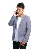 对电话的商人谈话 免版税库存照片
