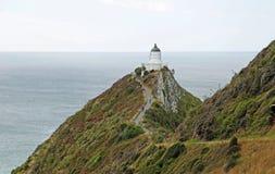 对矿块点灯塔的足迹 免版税库存照片