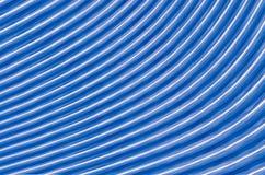 对称发光排行与运动零件的白色条纹作用的蓝色 库存图片