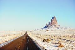 对纪念碑谷的雪高速公路163 图库摄影
