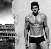 对背景人肌肉罗马墙壁 图库摄影