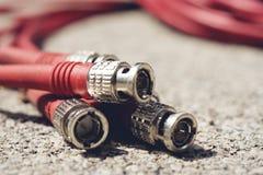 对记录的设备红色口气的CCTV缆绳RG6 RGB电视同轴类型 免版税库存照片