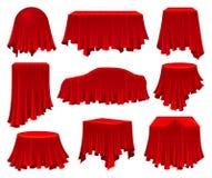 对象的汇集掩藏在红色布料下 皇族释放例证