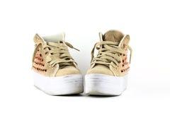 对质朴的使用的运动鞋鞋子 库存图片