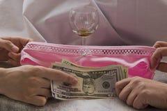 对金钱的爱是卖淫 库存照片