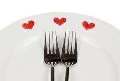 对餐馆的情人节晚餐白色背景的 免版税库存图片