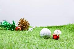 对高尔夫球运动员的圣诞快乐 库存图片