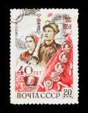 `对Komsomol `的40年,被给权` Komsomol在工业建筑` 它显示年轻建造者,大约1958年 免版税库存图片